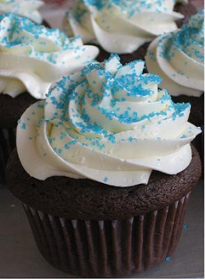 Cupcakes with white chocolate butter cream icing and blue sugar sprinkles
